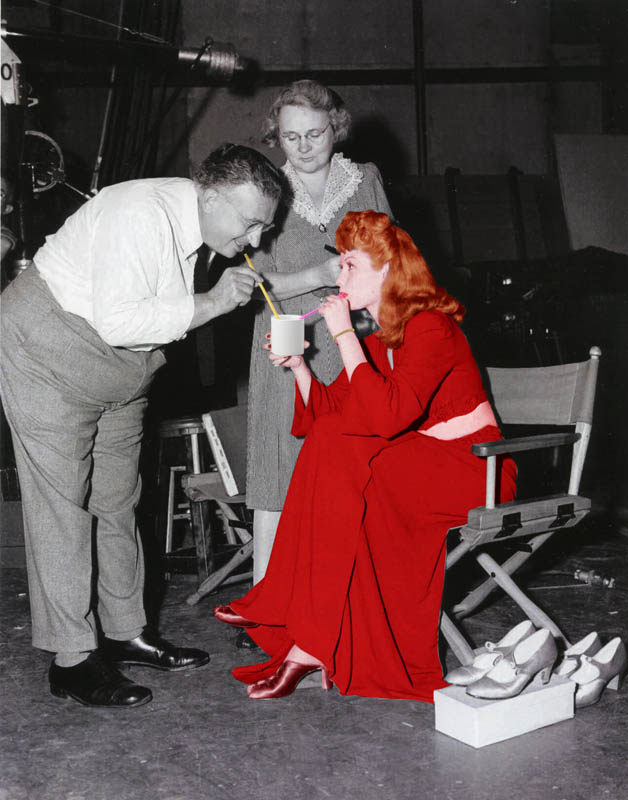 Dubarry Was a Lady (1943) Cinematographer Karl Freund checks the light for a scene with actress Lucille Ball.