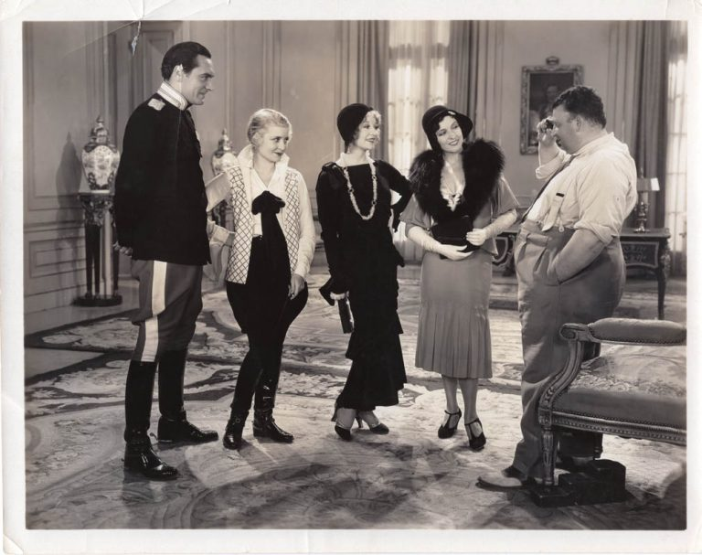 The Boudoir Diplomat (1930) Karl Freund on set with actors Ian Keith, Jeanette Loff, Betty Compson, and Mary Duncan.