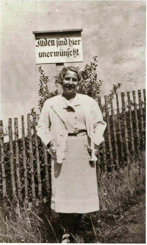 Susette Freund née Liepmannssohn, (The director's grandmother, Karl Freund's ex-wife) on vacation the Harz Mountains. Sign reads: Jews Are Not Welcome Here.